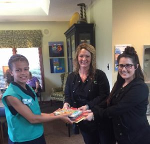 Jessica & Sulina accepted children's books today from Johanna and the Girl Scouts!
